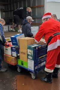 Volunteers unload donated food image